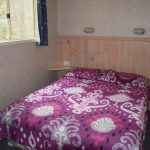 The cabin's main bedroom double bed had an electric blanket