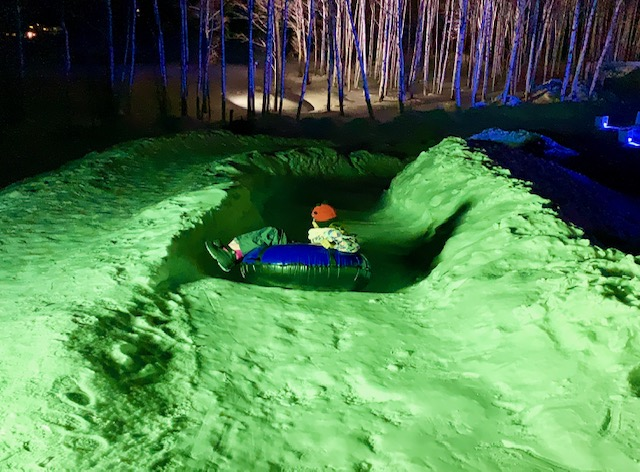 Take a ride on an inflatable ring down a snow or ice slide!