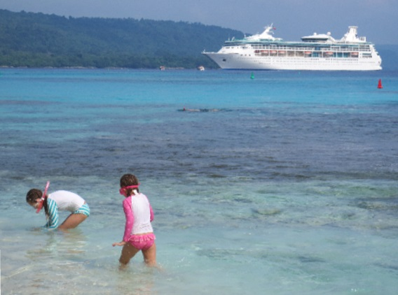 Kids can snorkel in shallow water to discover beautiful fish & coral at island ports-of-call