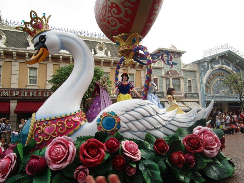 Snow white thrills the crowds from her beautiful white swan float