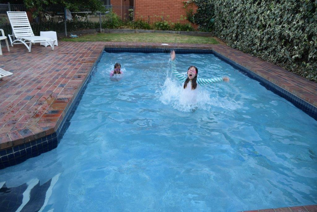 Brrr - pretty cold in, but the kids don't mind! A cool-off in the Parkview Inn pool