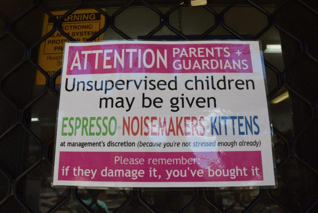 A sign in the window of the souvenir shop - I am definitely supervising in this shop!