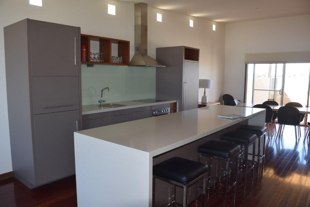 This kitchen looks sleek and slimline, yet it's hiding lots of state-of-the-art appliances!
