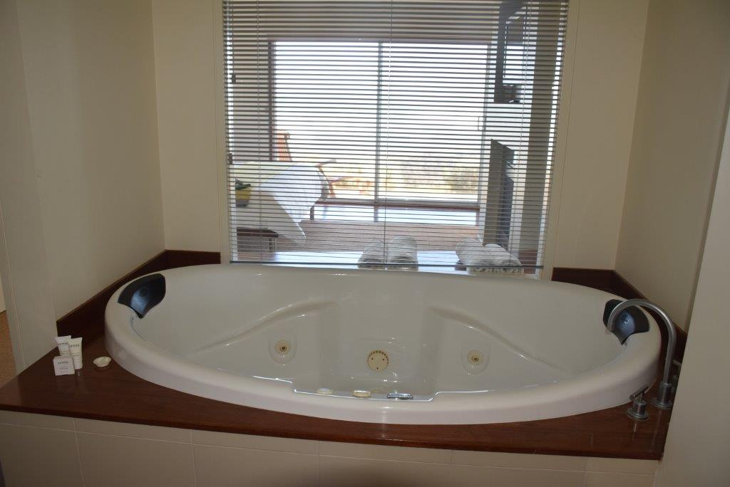 The enormous bathroom Jacuzzi is opulent luxury with a great view!