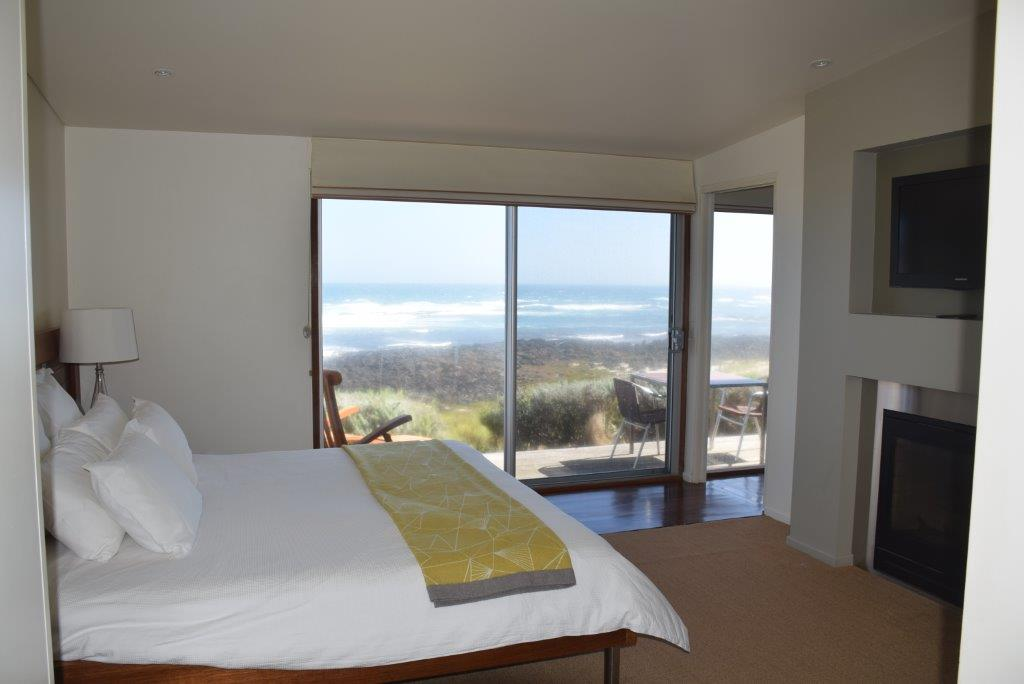The master bedroom has a gas fire, TV & window to the Jacuzzi - and its views are unsurpassed