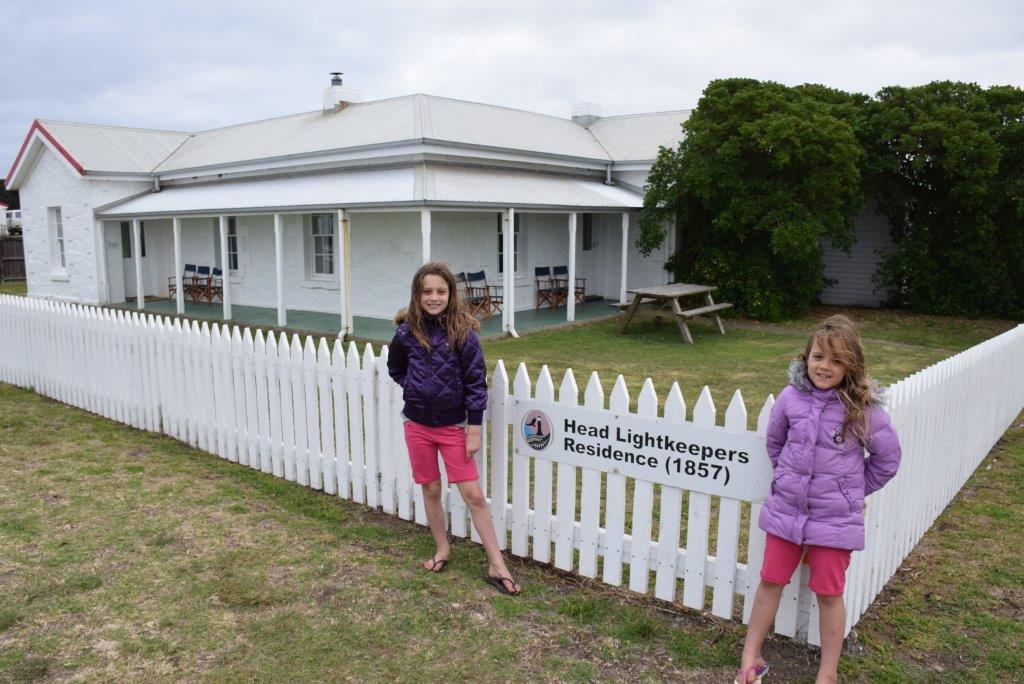 The girls proudly show off their home for two nights - the Head Lighthouse Keepers house!