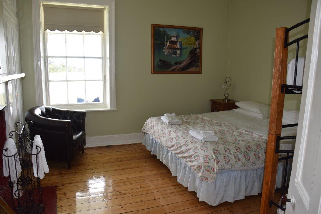 The Head Lightkeeper's House Master bedroom has lighthouse and ocean views