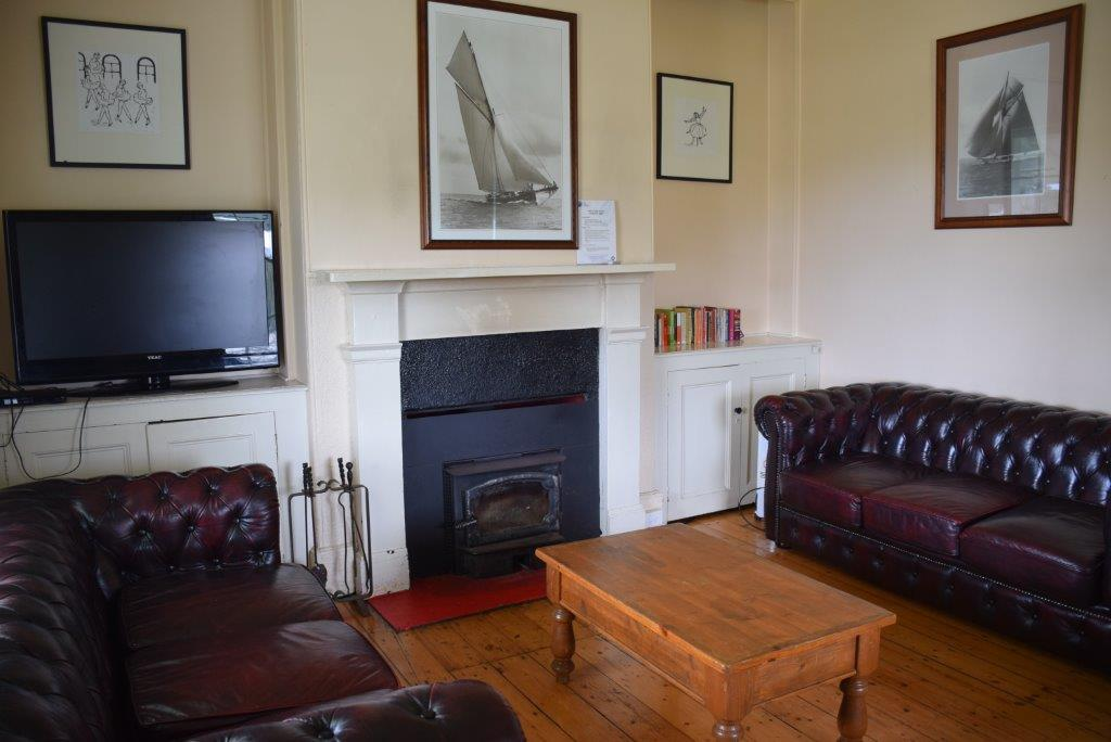 The lounge is spacious yet cosy with a wood fire