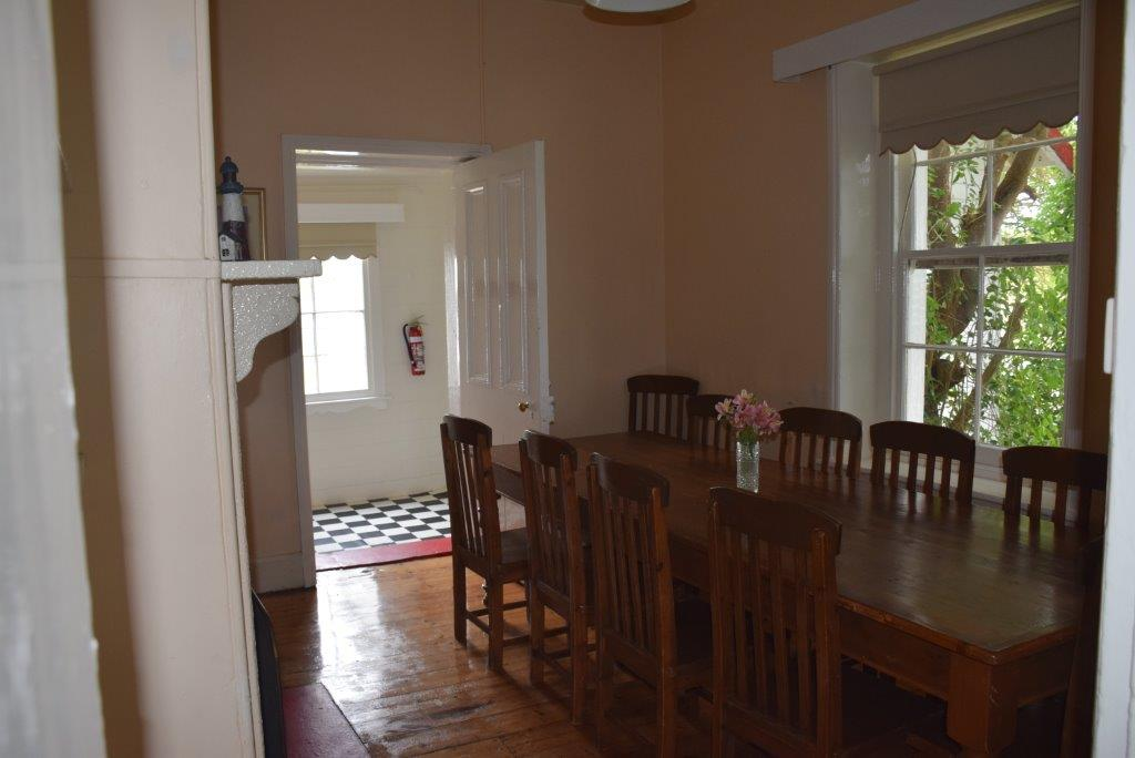 The large dining room with huge dining table seats 10