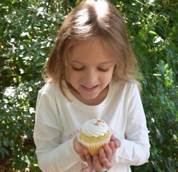 These look good enough to eat! Samantha savours her Cupcakes Delivered cupcake