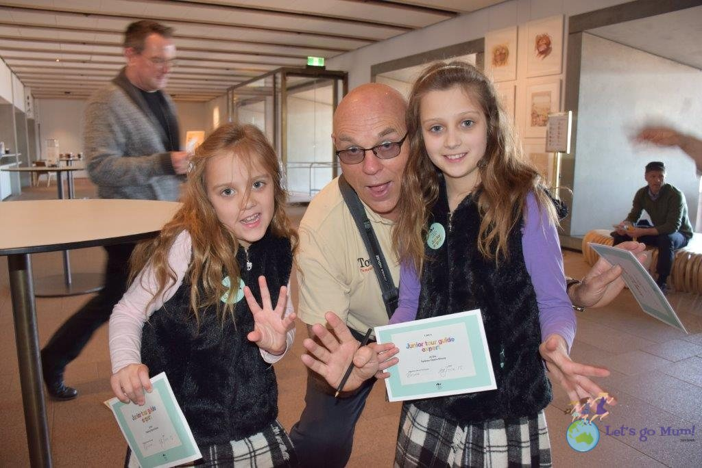 Bruce, tour guide extraordinaire presents the girls with their certificates