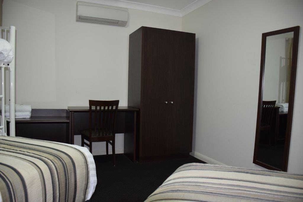 The children's bedroom also features a wardrobe and desk, and separate climate control