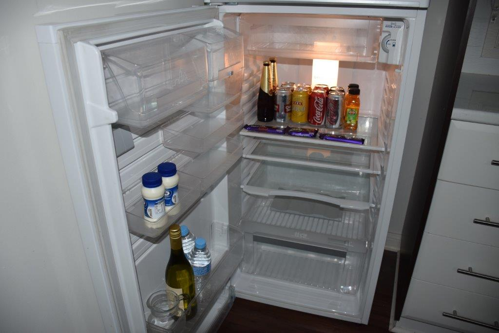 The kitchen has a large fridge stocked with mini bar goodies!