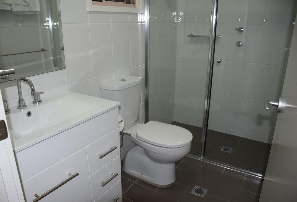 A modern bathroom with a great shower