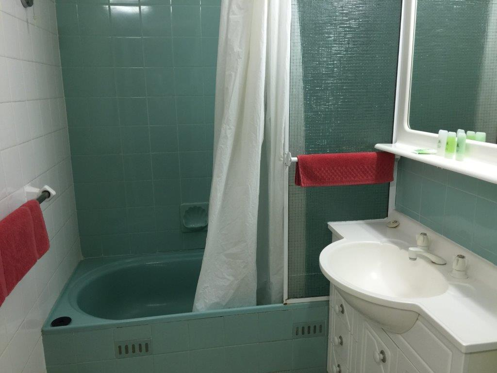 The bathroom is clean and serviceable with a good shower