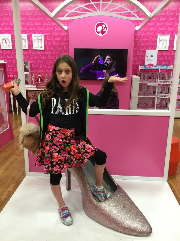 Brooke models a giant shoe in the Barbie section of the Myer toy department