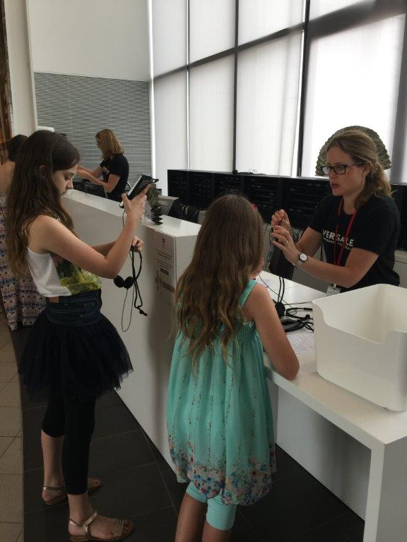 The girls get set up with their audio tours