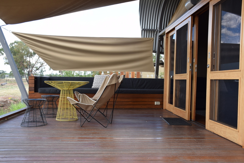 The Zoofari Lodge deck is spacious, with outdoor furniture and a comfy padded lounge