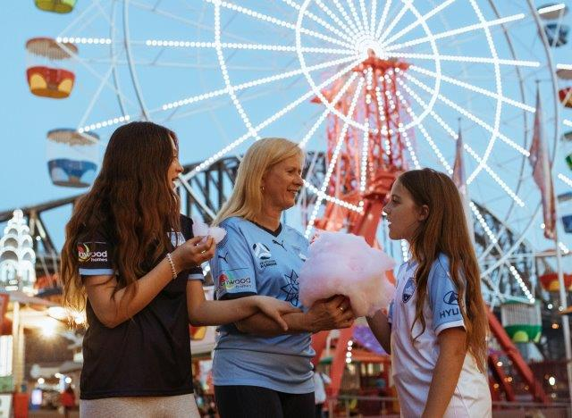 Dream photo-shoot - the girls get to eat fairy floss at Luna Park!
