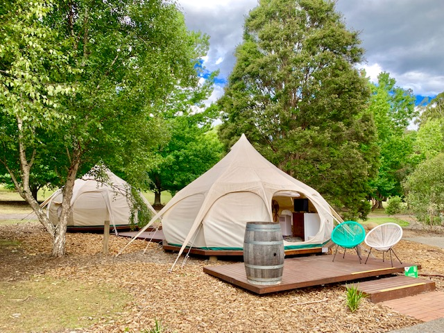 The two family bell tents are linked by a deck