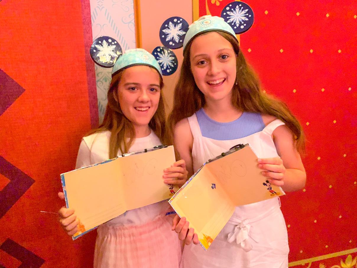 Elsa even signed our autograph books!