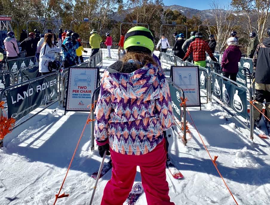 Socially distanced ski lift queues at Thredbo Village Ski Resort