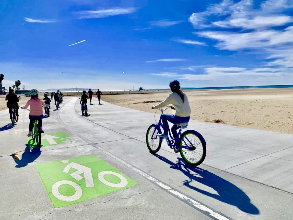 Hire a bike and ride along the beach paths