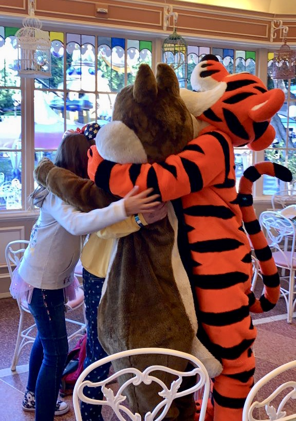 Disneyland breakfast hugs